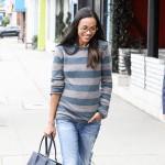 Zoe Saldana luce el bolso Paris Premier de Longchamp